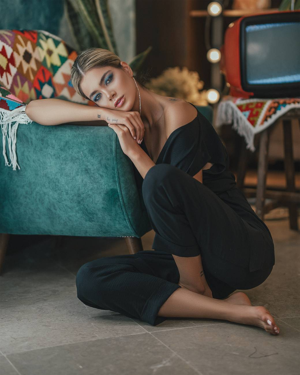 attractive woman sitting on floor in room